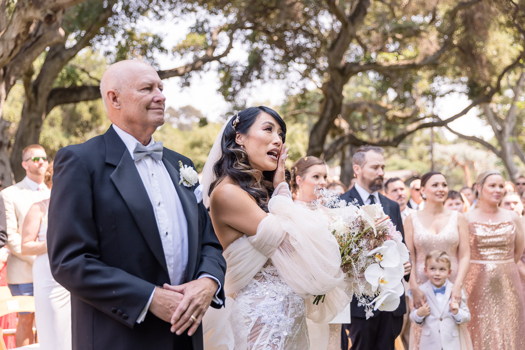 bride got emotional down at the aisle