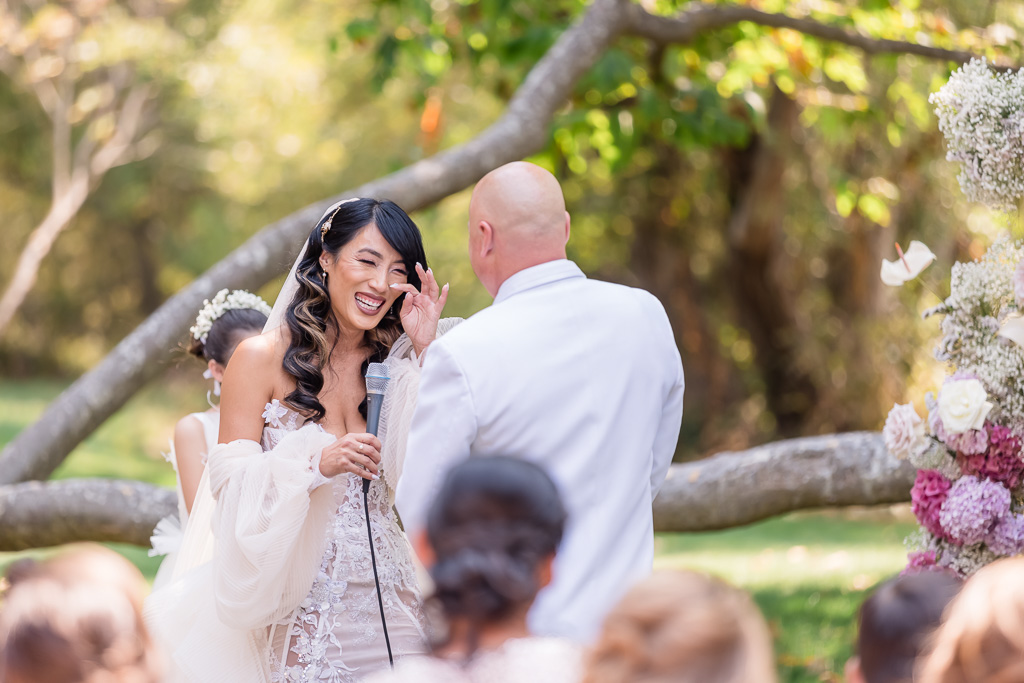 bride wiping away her happy tears when exchanging vows