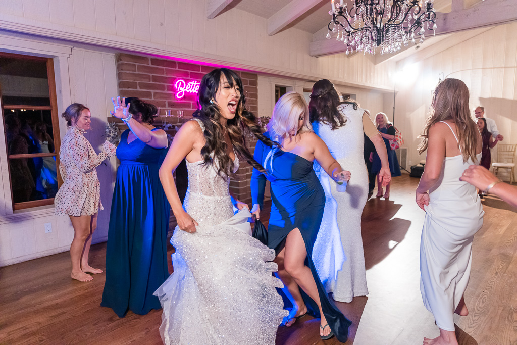 bride dancing with the girls