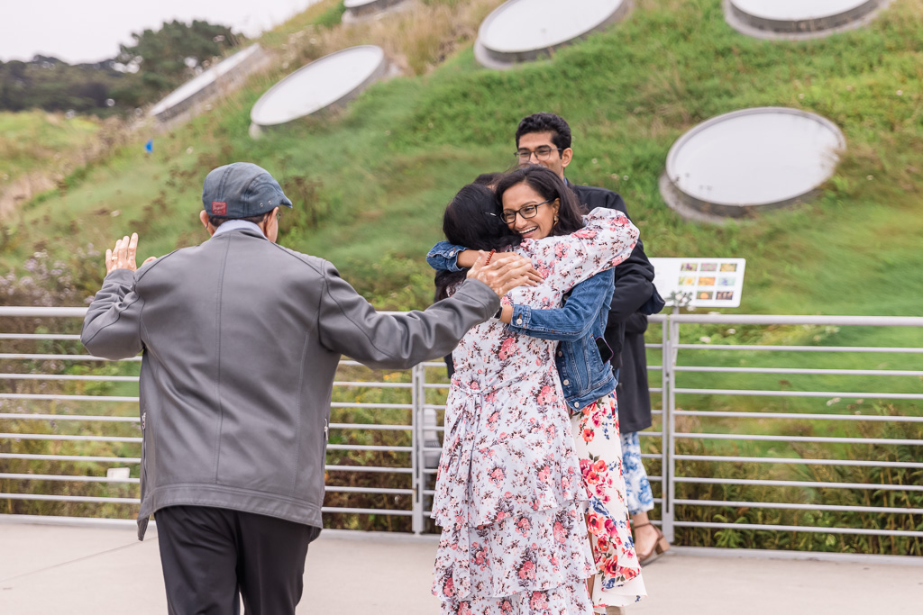 parents surprising newly engaged couple after getting engaged