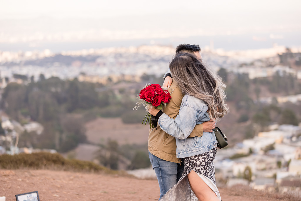 engaged couple with roses